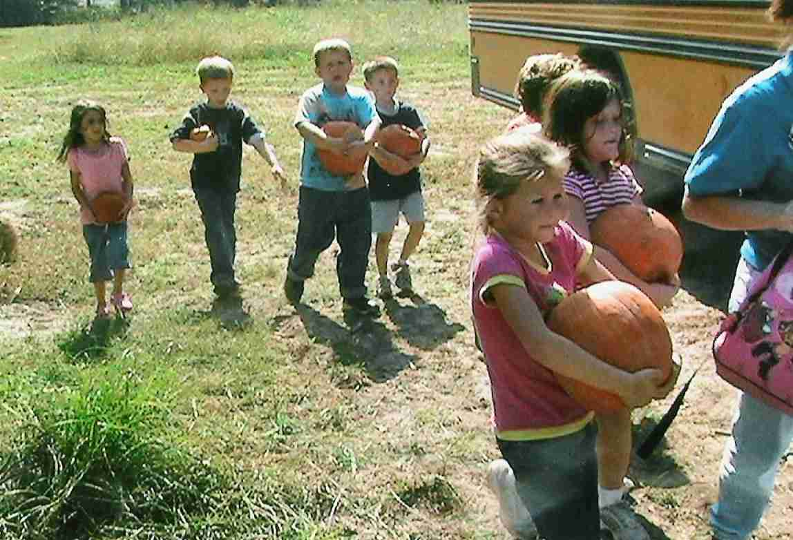 kids with their pumpkins